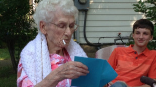 Meagan's grandma enjoying a candy cigarette on her 90th birthday.