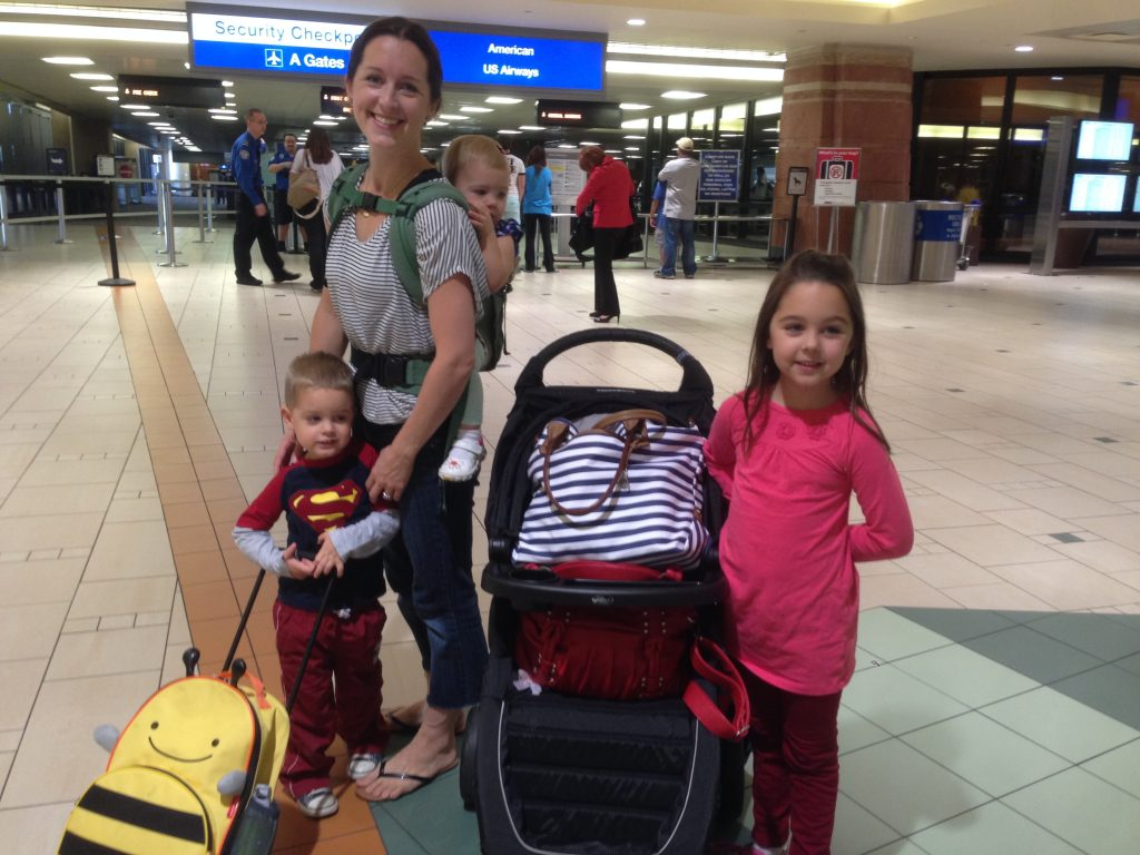 flying alone with three kids